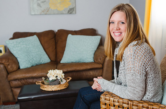 Woman sits in living room