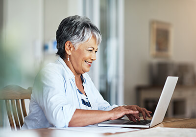 Woman completing survey on computer