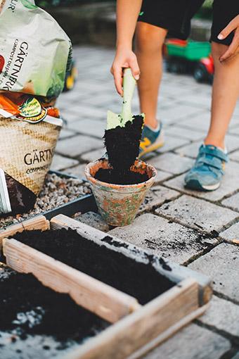 child shoveling soil