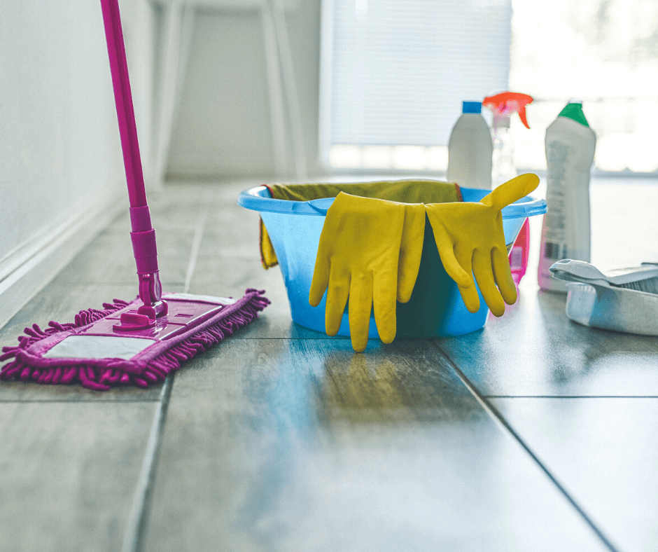 Dust mop, bucket, cleaning gloves and spray cleaners