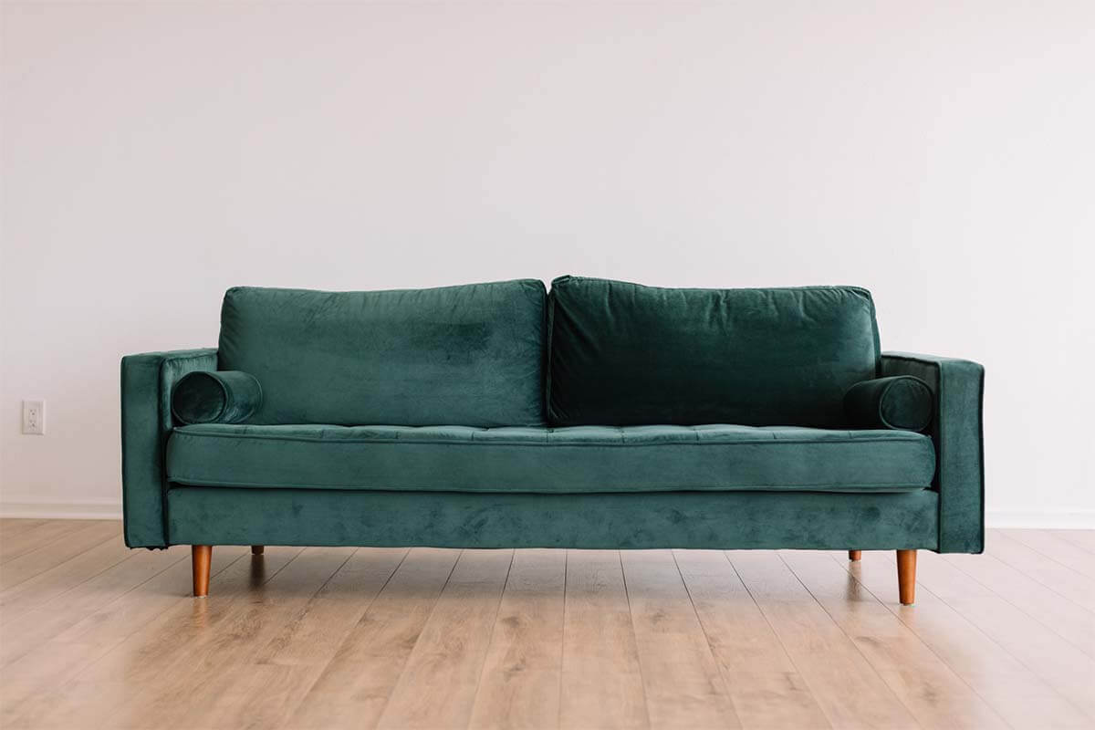 Green velour couch. Photo credit: Phillip Goldsberry